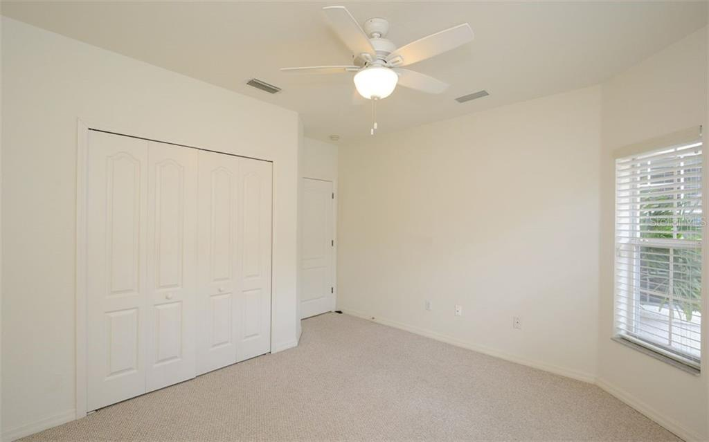 Guest bedroom - Villa for sale at 313 Auburn Woods Cir, Venice, FL 34292 - MLS Number is N6101432
