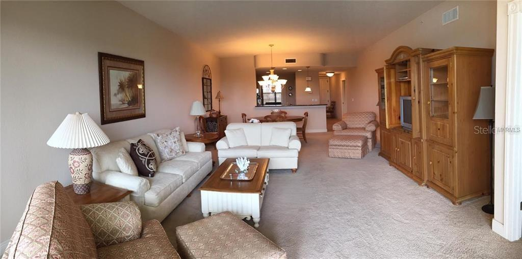 Living and dining area from balcony - Condo for sale at 157 Tampa Ave E #407, Venice, FL 34285 - MLS Number is N6101715