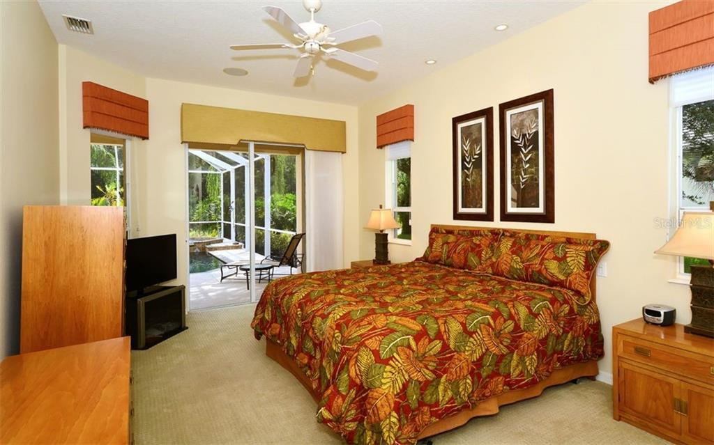 Master bedroom with sliders to pool - Single Family Home for sale at 913 Chickadee Dr, Venice, FL 34285 - MLS Number is N6101770