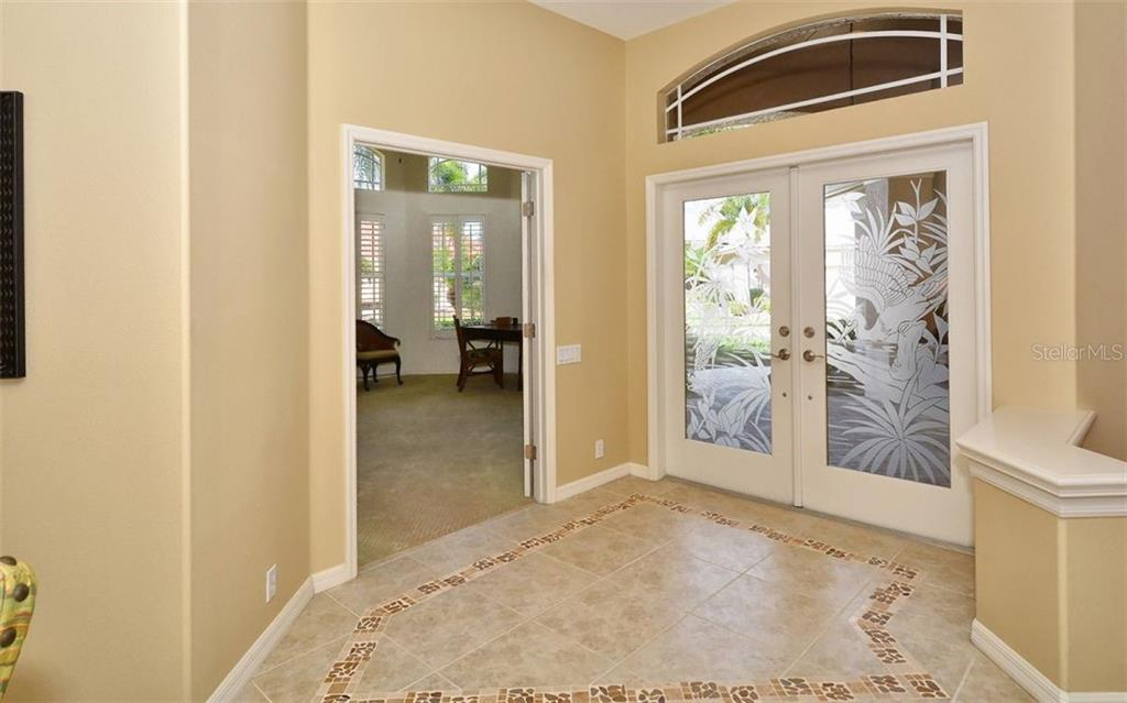 Foyer to study/den - Single Family Home for sale at 913 Chickadee Dr, Venice, FL 34285 - MLS Number is N6101770