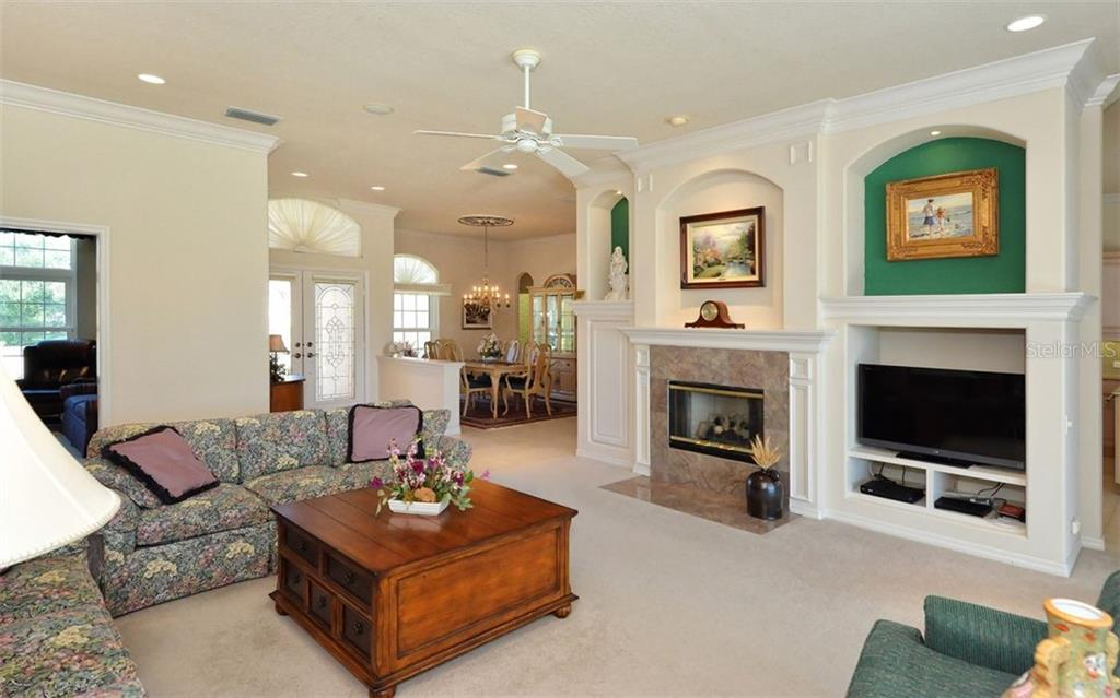 Great room to dining room - Single Family Home for sale at 979 Chickadee Dr, Venice, FL 34285 - MLS Number is N6102266