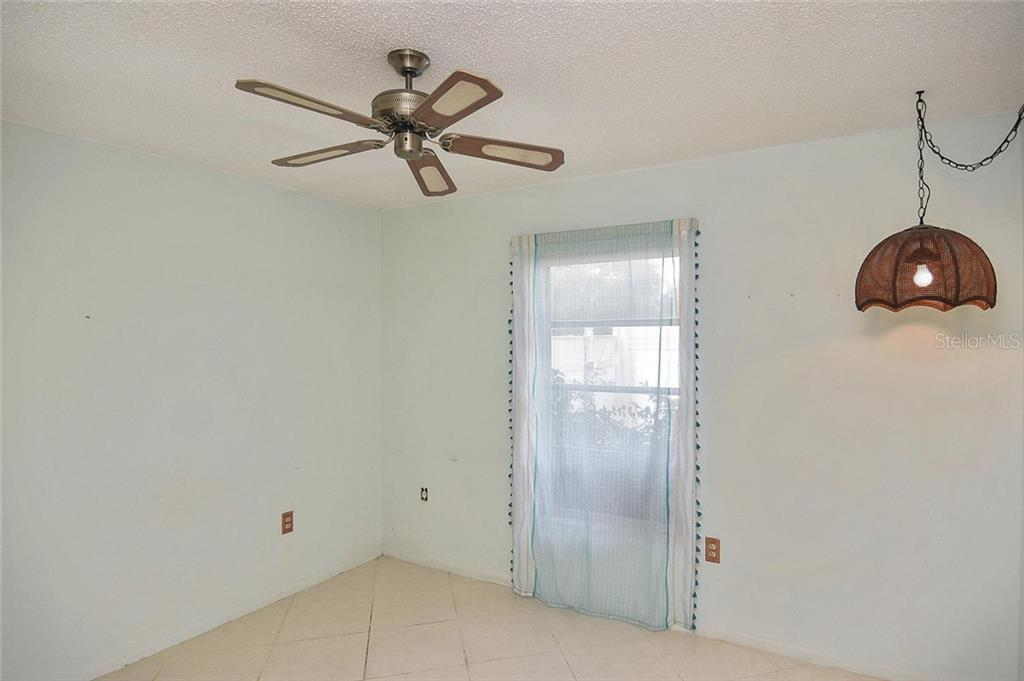 Guest bedroom - Single Family Home for sale at 1885 Neptune Dr, Englewood, FL 34223 - MLS Number is N6103051