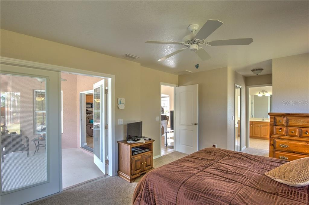 From the master looking at sliders to lanai, double walk-in closets and bathroom - Single Family Home for sale at 6612 Deer Run Rd, North Port, FL 34291 - MLS Number is N6103231