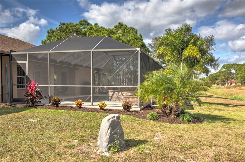 Plenty of space to the right of the house - Single Family Home for sale at 6612 Deer Run Rd, North Port, FL 34291 - MLS Number is N6103231
