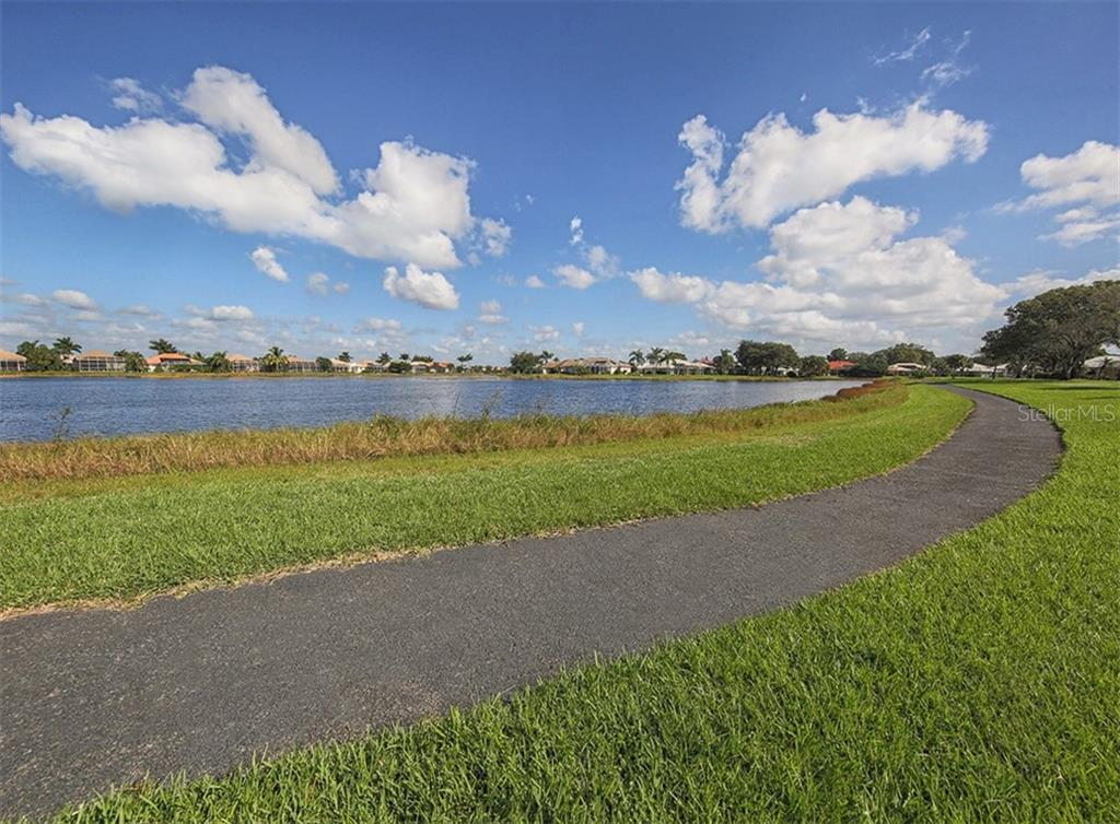 Community - Single Family Home for sale at 627 Lakescene Dr, Venice, FL 34293 - MLS Number is N6103268