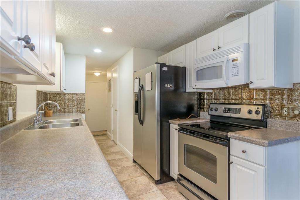 updated kitchen, stainless appliances, and beautiful back splash. - Single Family Home for sale at 3656 Clematis Rd, Venice, FL 34293 - MLS Number is N6103558