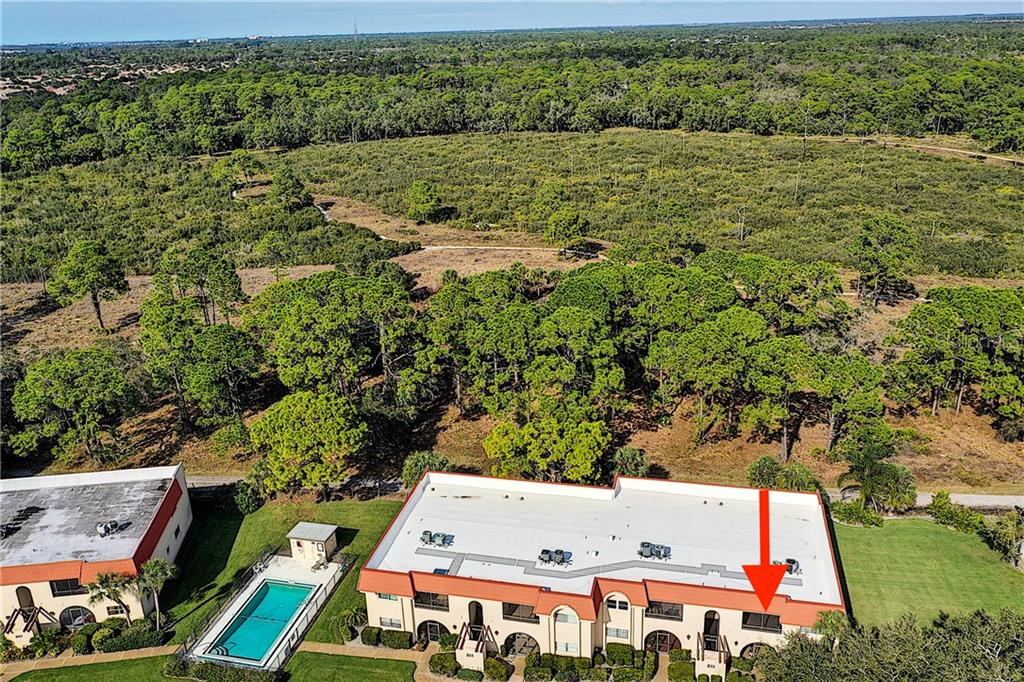 Aerial - note how close to the community pool - Condo for sale at 211 Rubens Dr #h, Nokomis, FL 34275 - MLS Number is N6103629