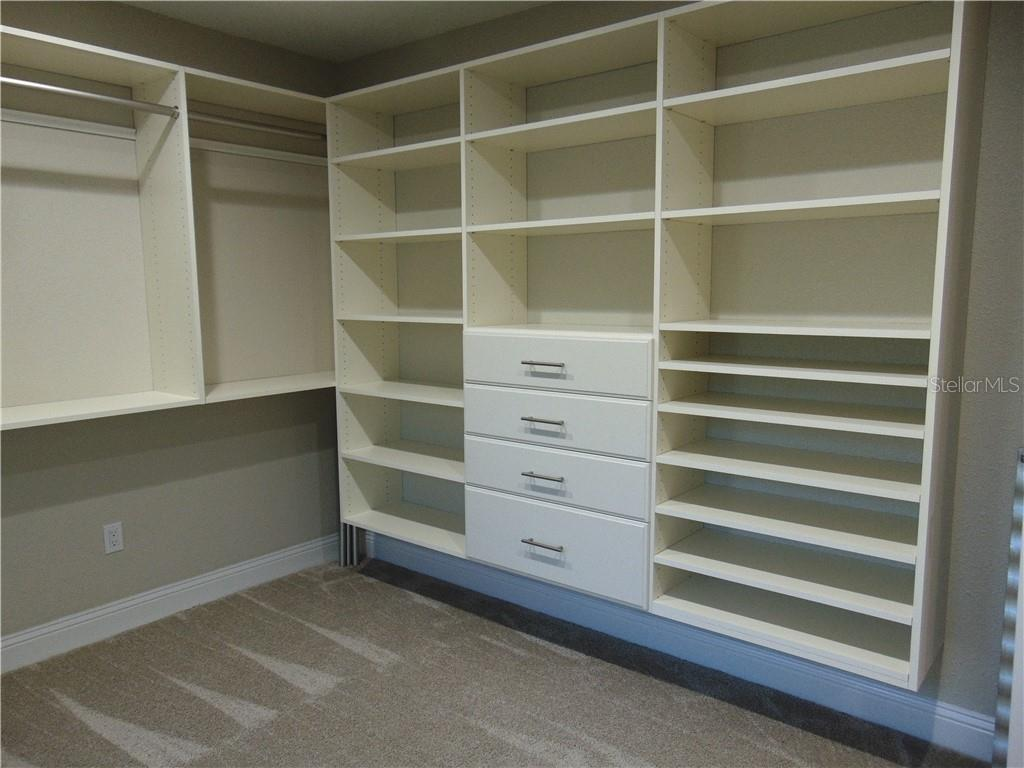 Master closet with built in's - Single Family Home for sale at 425 Harbor Dr S, Venice, FL 34285 - MLS Number is N6103861