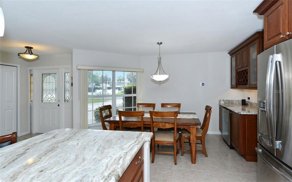 Kitchen to dining room - Single Family Home for sale at 1460 Strada D Argento, Venice, FL 34292 - MLS Number is N6104612