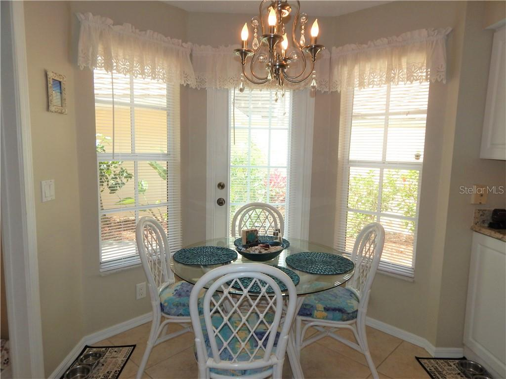 EAT-IN KITCHEN NOOK, BAY WINDOW WITH DOOR LEADING TO PATIO - Villa for sale at 572 Clubside Cir #34, Venice, FL 34293 - MLS Number is N6105221