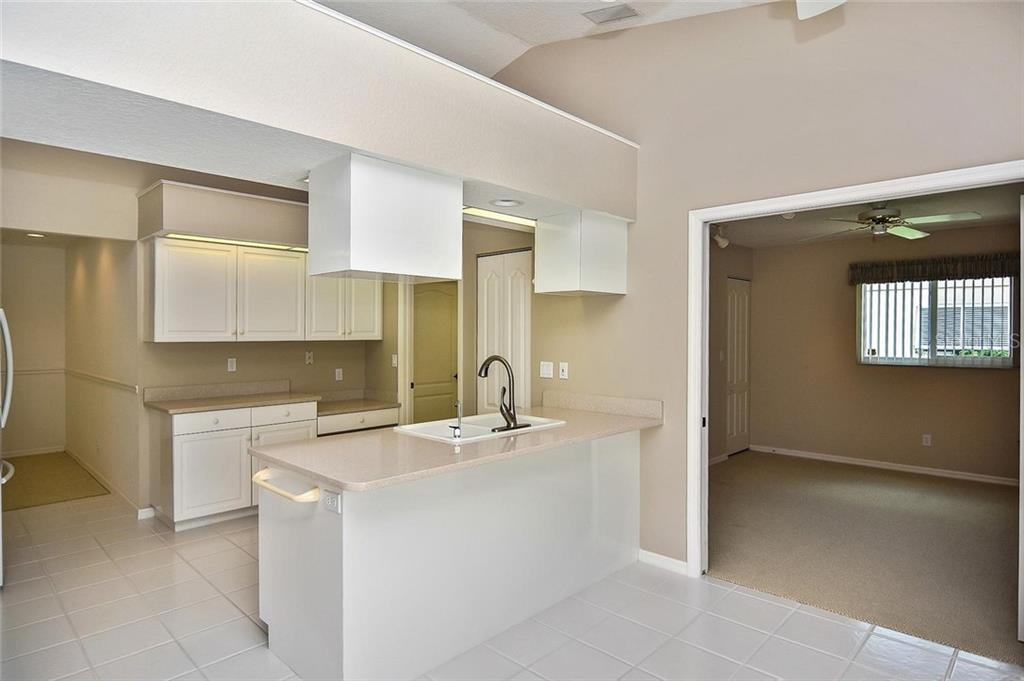Kitchen to bedroom - Single Family Home for sale at 2232 E Village Cir, Venice, FL 34293 - MLS Number is N6105697