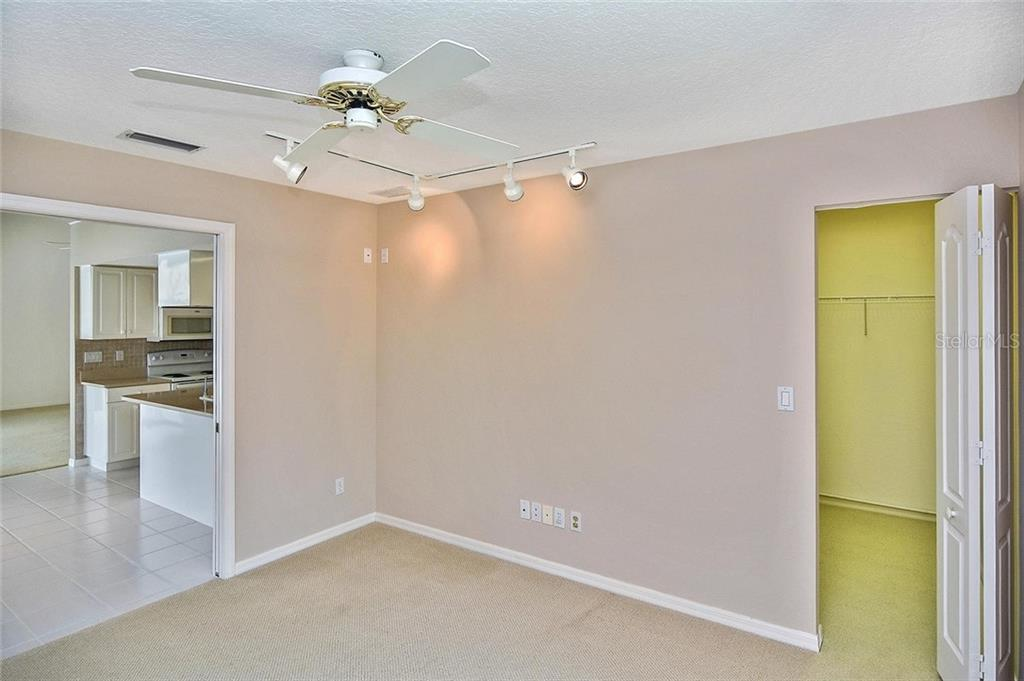 Bedroom to kitchen - Single Family Home for sale at 2232 E Village Cir, Venice, FL 34293 - MLS Number is N6105697