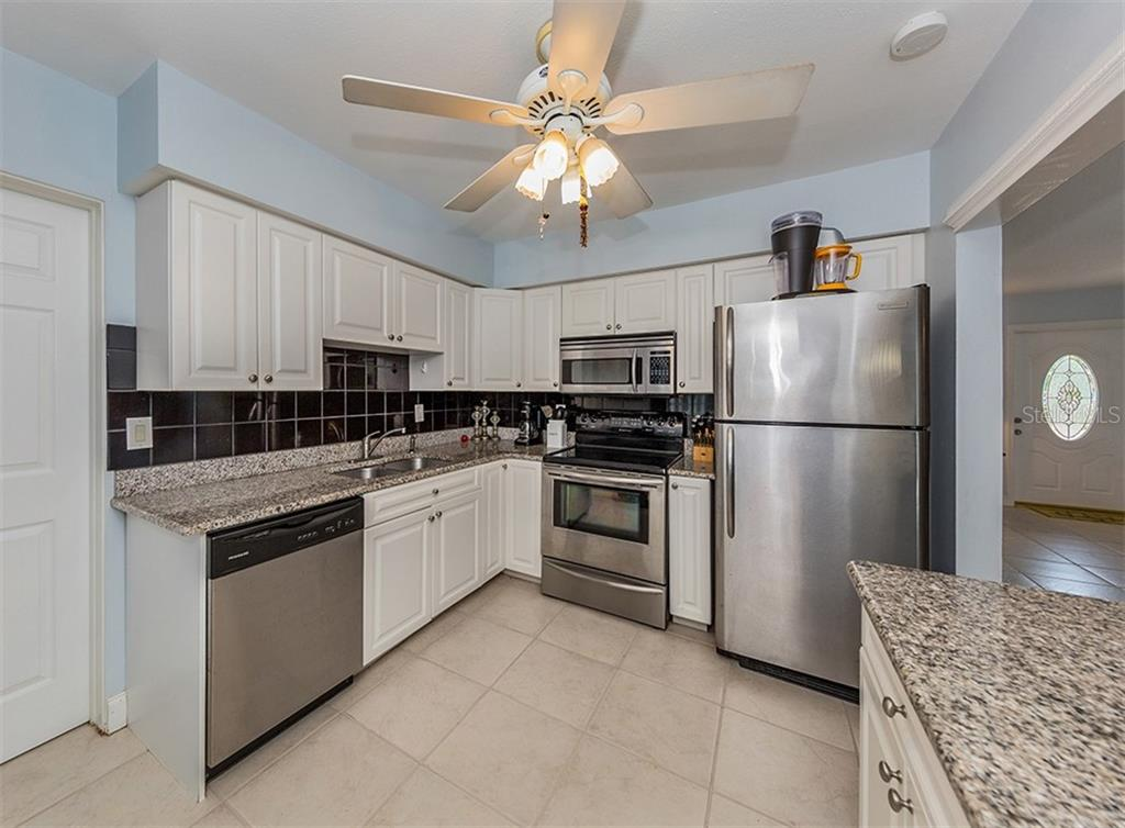 Kitchen - Single Family Home for sale at 409 Darling Dr, Venice, FL 34285 - MLS Number is N6105760