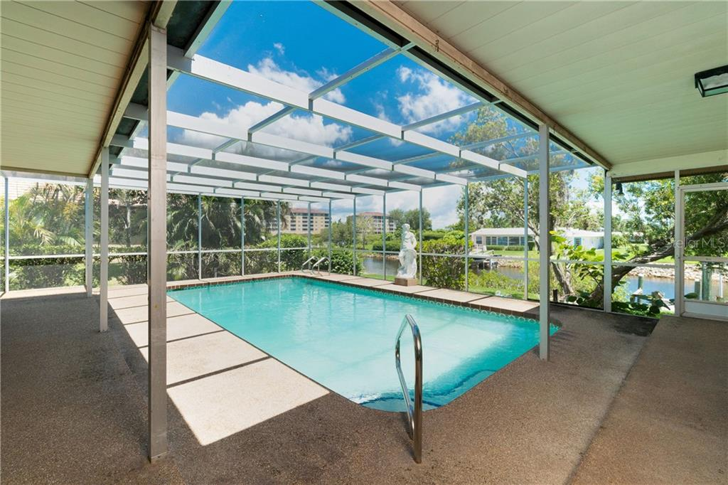 Pool with covered lanai overlooking canal - Single Family Home for sale at 359 Renoir Dr, Osprey, FL 34229 - MLS Number is N6106429