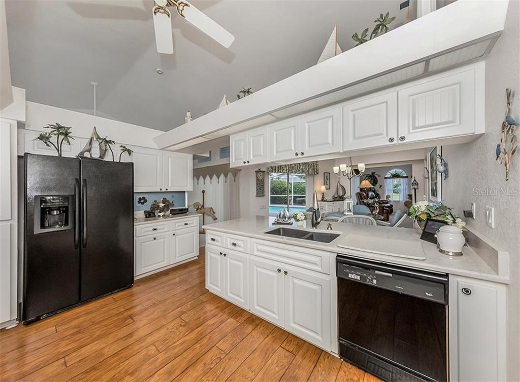 Kitchen - Single Family Home for sale at 4956 Stonecastle Dr, Venice, FL 34293 - MLS Number is N6107106