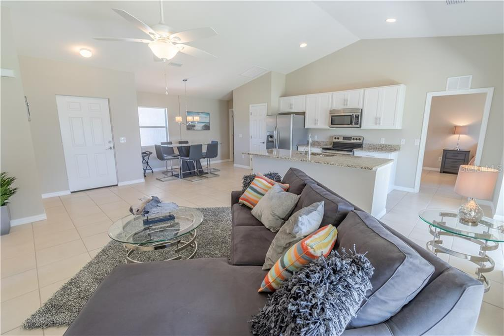 Similar completed home - Single Family Home for sale at 230 Shamrock Dr, Venice, FL 34293 - MLS Number is N6107398