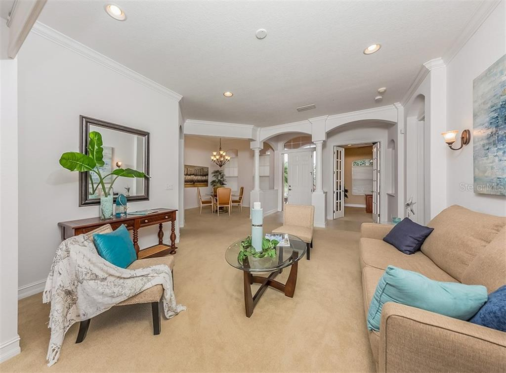 Formal Living Room  Opens To The Lanai - Single Family Home for sale at 262 Pesaro Dr, North Venice, FL 34275 - MLS Number is N6107589