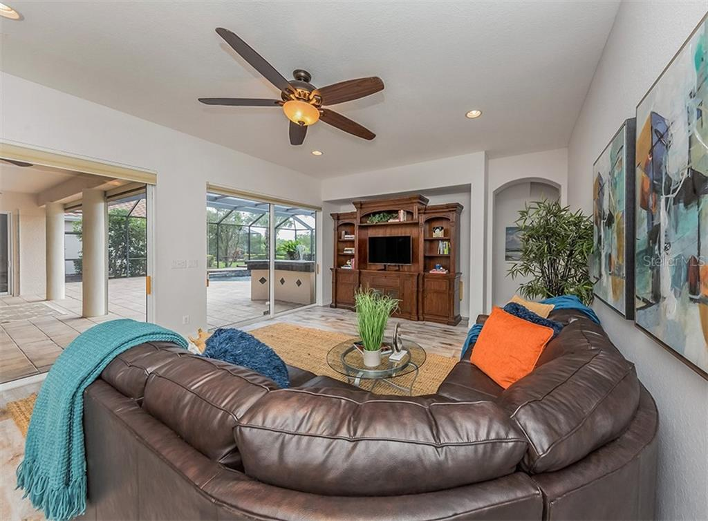 Great room with sliders to lanai and pool. - Single Family Home for sale at 262 Pesaro Dr, North Venice, FL 34275 - MLS Number is N6107589