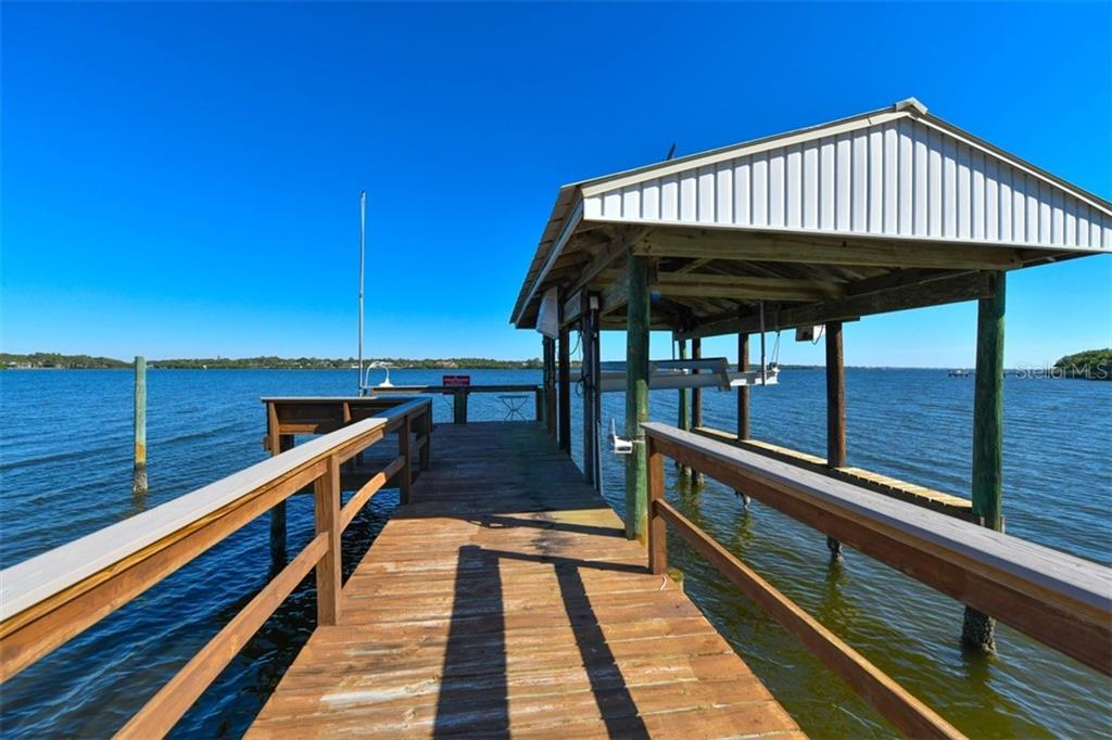 Boat house and boat slip - Single Family Home for sale at 7785 Manasota Key Rd, Englewood, FL 34223 - MLS Number is N6107786