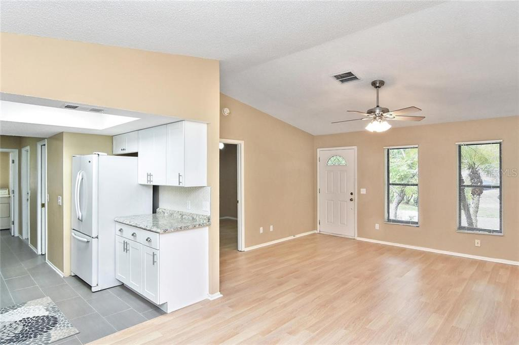 Kitchen, living room - Single Family Home for sale at 5681 Hale Rd, Venice, FL 34293 - MLS Number is N6107822