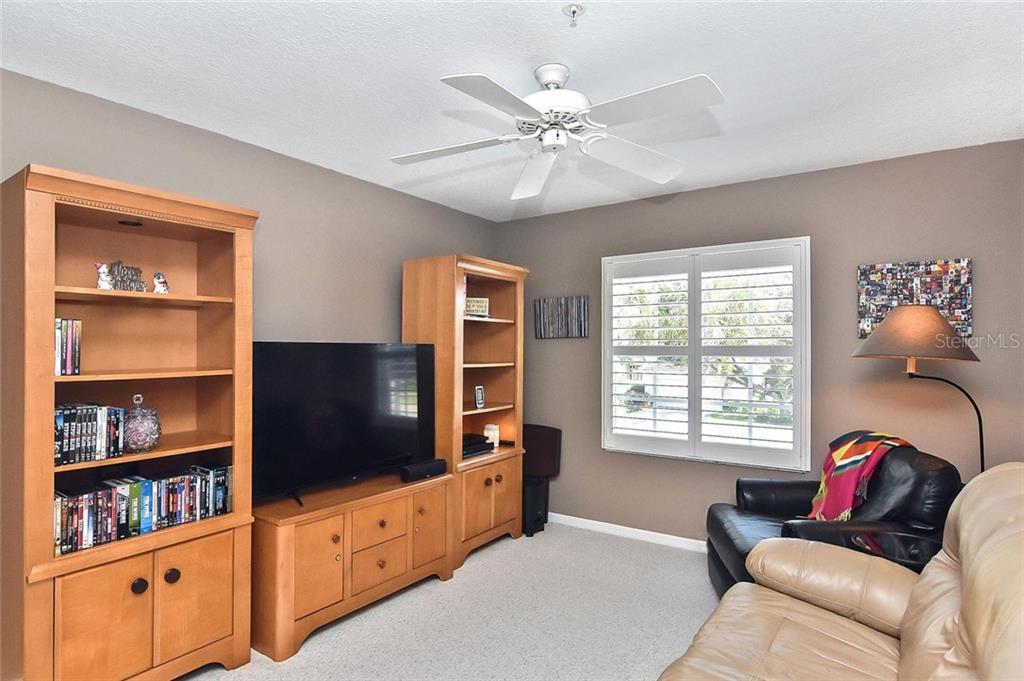 Bedroom 3, being used as a TV room - Condo for sale at 817 Montrose Dr #204, Venice, FL 34293 - MLS Number is N6108125
