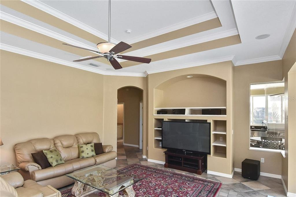 Family room - Single Family Home for sale at 321 Dulmer Dr, Nokomis, FL 34275 - MLS Number is N6108685