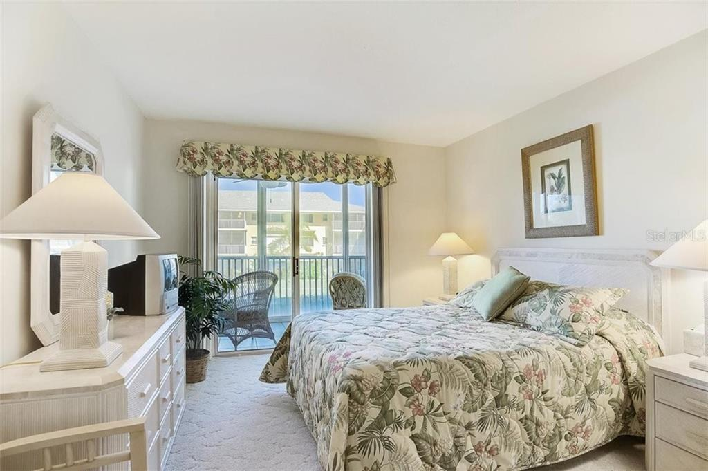 Guest bedroom with slider to lanai - Condo for sale at 1150 Tarpon Center Dr #203, Venice, FL 34285 - MLS Number is N6108842