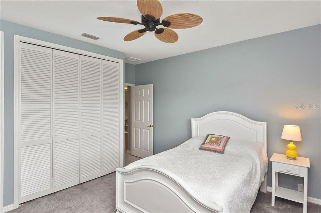 Bedroom 4 is off of the bonus room and has its own bathroom - Single Family Home for sale at 7185 N Serenoa Dr, Sarasota, FL 34241 - MLS Number is N6109058
