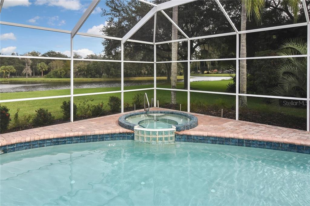 A hot tub with a calming view - what's not to love! - Single Family Home for sale at 7185 N Serenoa Dr, Sarasota, FL 34241 - MLS Number is N6109058