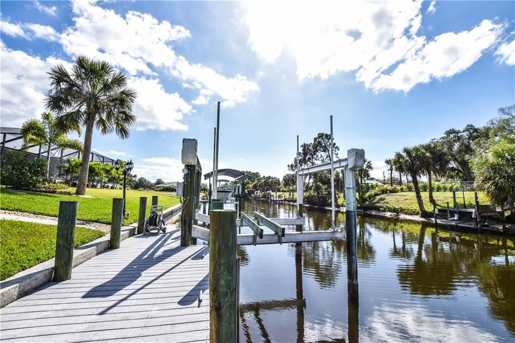 Looking down canal in opposite direction. - Single Family Home for sale at 2560 Pebble Creek Pl, Port Charlotte, FL 33948 - MLS Number is N6109100