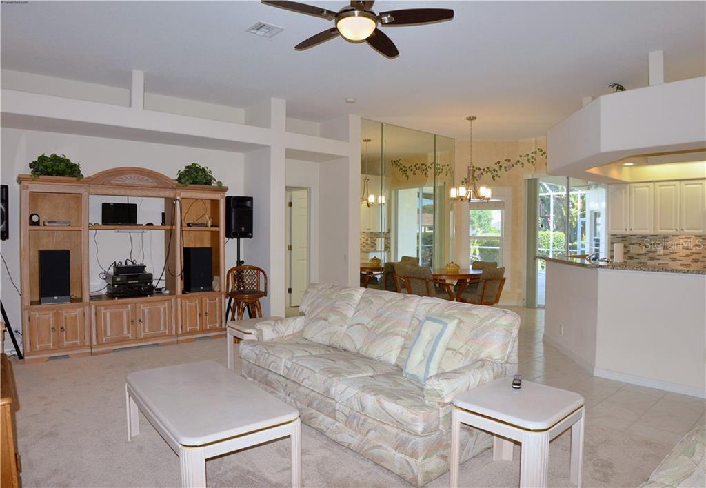 Great room, breakfast nook, kitchen - Single Family Home for sale at 413 Pebble Creek Ct, Venice, FL 34285 - MLS Number is N6110166