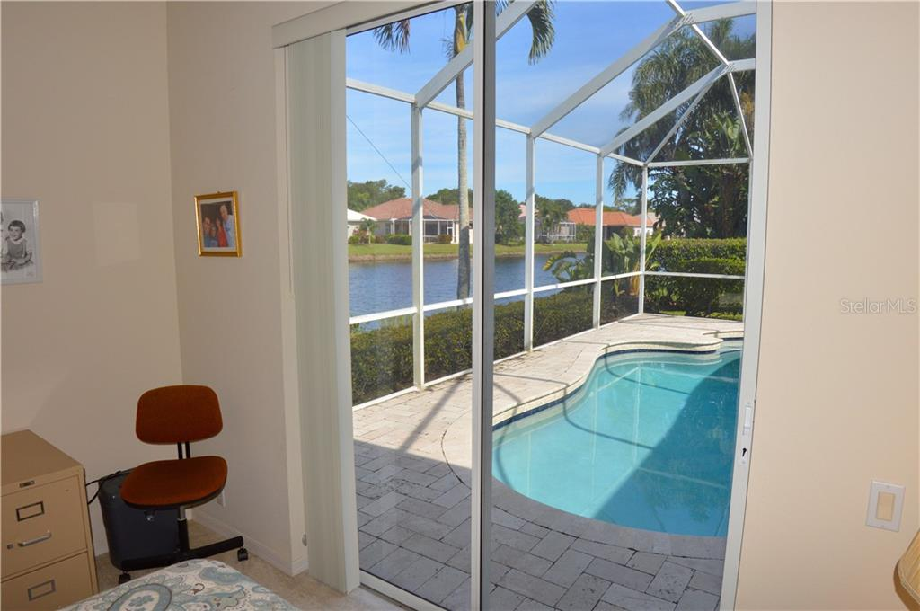 Bedroom 3 to pool - Single Family Home for sale at 413 Pebble Creek Ct, Venice, FL 34285 - MLS Number is N6110166