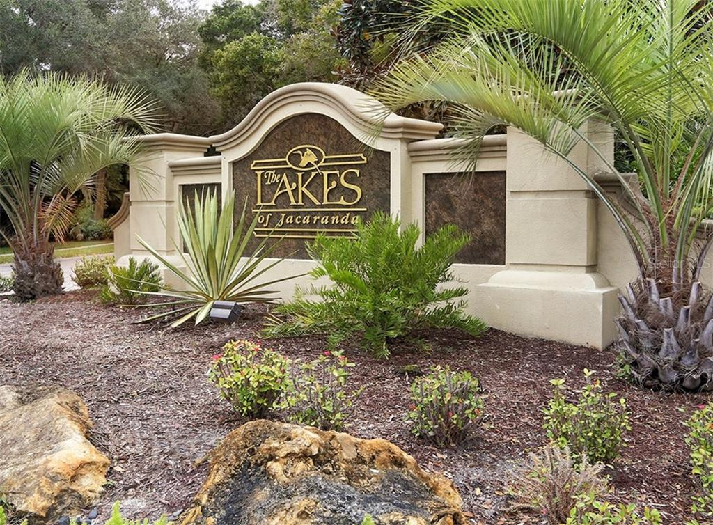 Monument at entrance to The Lakes of Jacaranda - Single Family Home for sale at 498 Pine Lily Way, Venice, FL 34293 - MLS Number is N6110849