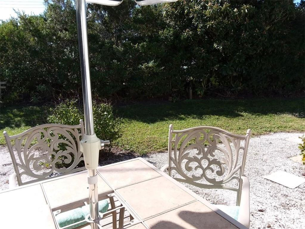 Just listen to the birds singing as you relax in your private yard - Single Family Home for sale at 707 S Green Cir #71, Venice, FL 34285 - MLS Number is N6111316