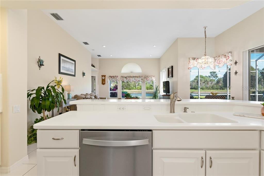 Water view from kitchen - Single Family Home for sale at 886 Macaw Cir, Venice, FL 34285 - MLS Number is N6111692