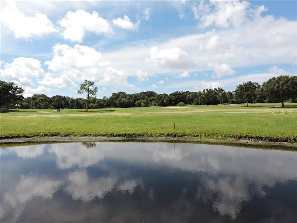 View from Lanai and Patio over looking the golf course and pond - Condo for sale at 1041 Capri Isles Blvd #121, Venice, FL 34292 - MLS Number is N6112042