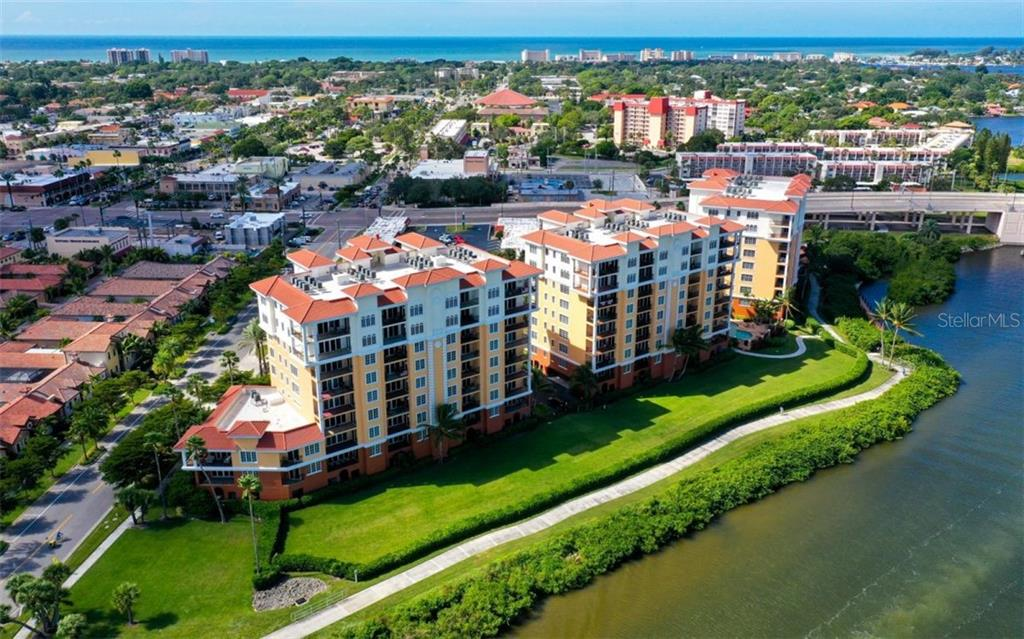 Building on the left - Condo for sale at 167 Tampa Ave E #313, Venice, FL 34285 - MLS Number is N6112536