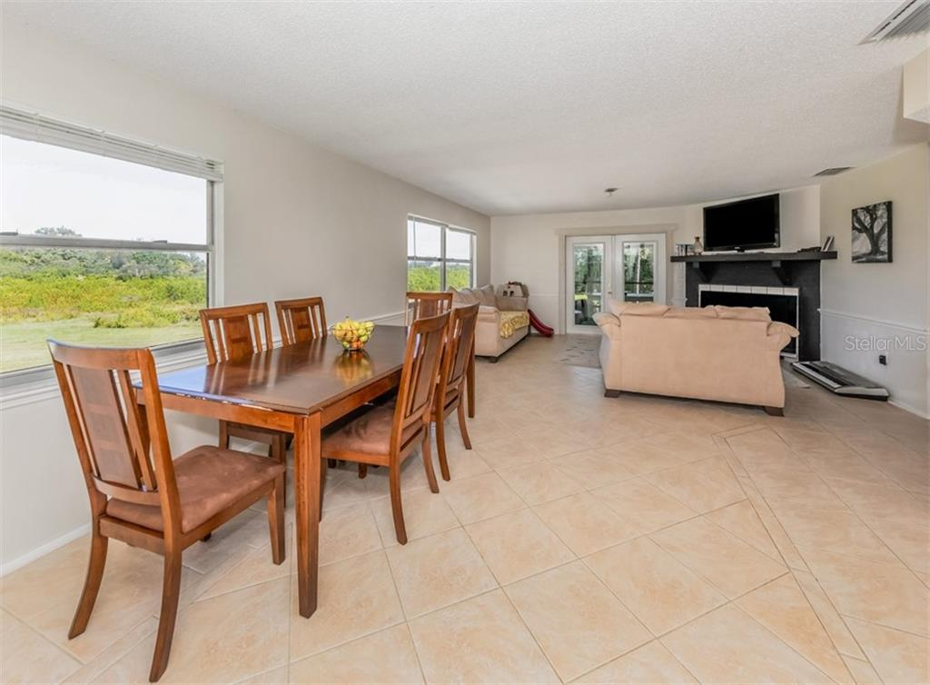 Dining area, great room - Single Family Home for sale at 9425 Myakka Dr, Venice, FL 34293 - MLS Number is N6112567