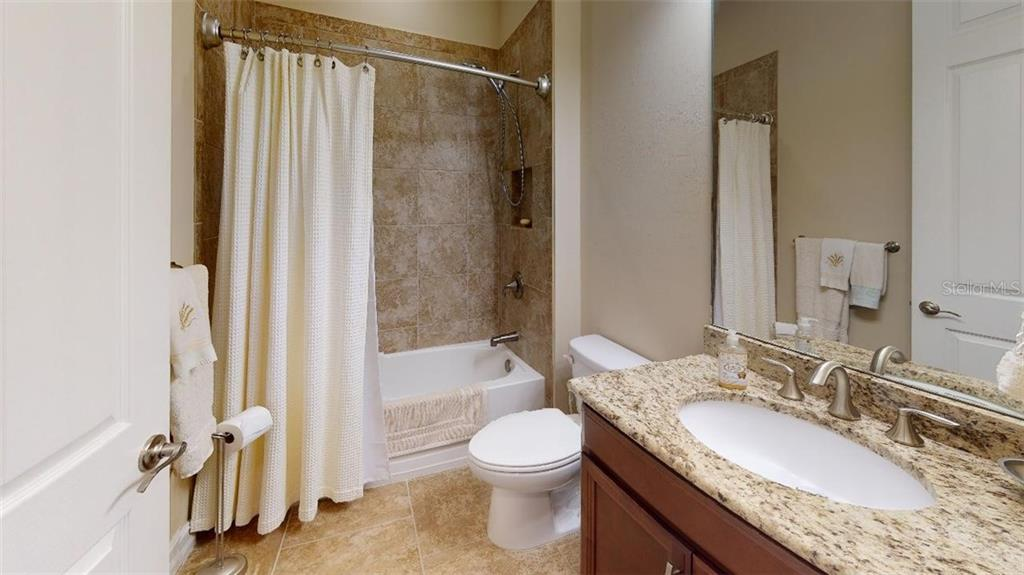GUEST BATHROOM - Single Family Home for sale at 1051 Bradberry Dr, Nokomis, FL 34275 - MLS Number is N6112687
