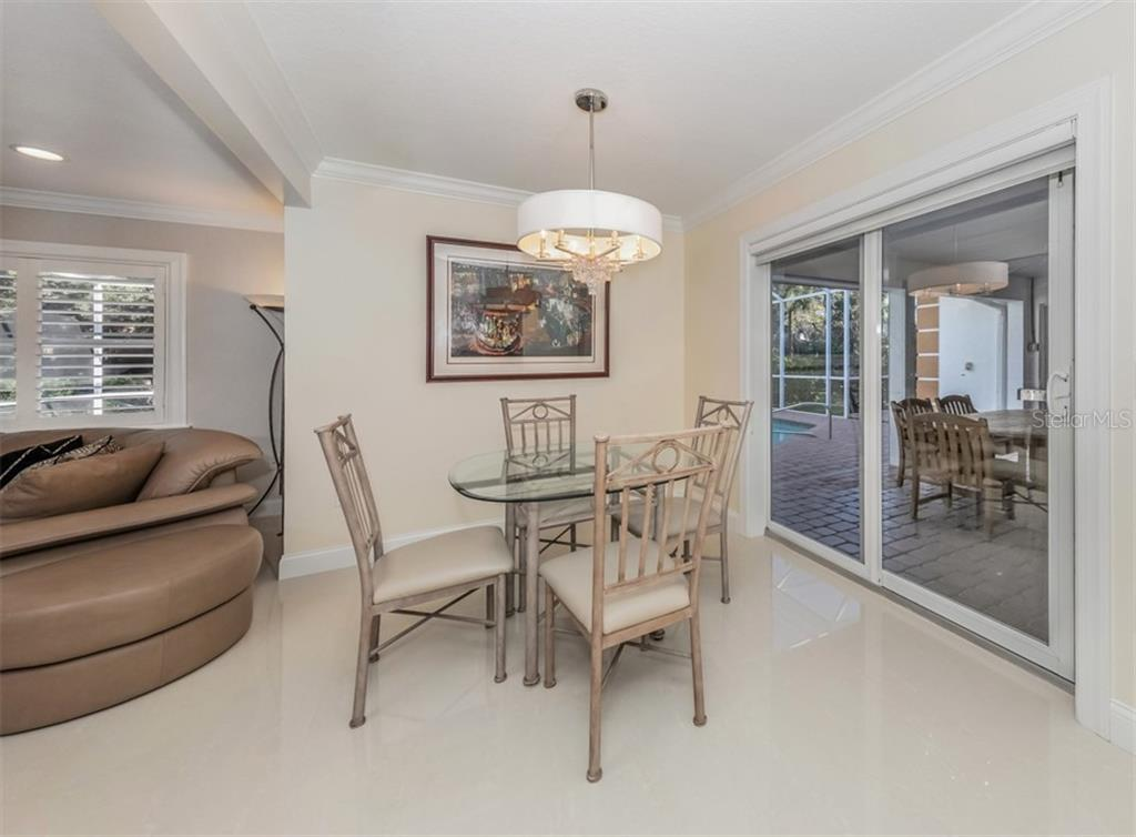 Dinette with sliders to the lanai - Single Family Home for sale at 1321 Guilford Dr, Venice, FL 34292 - MLS Number is N6113272