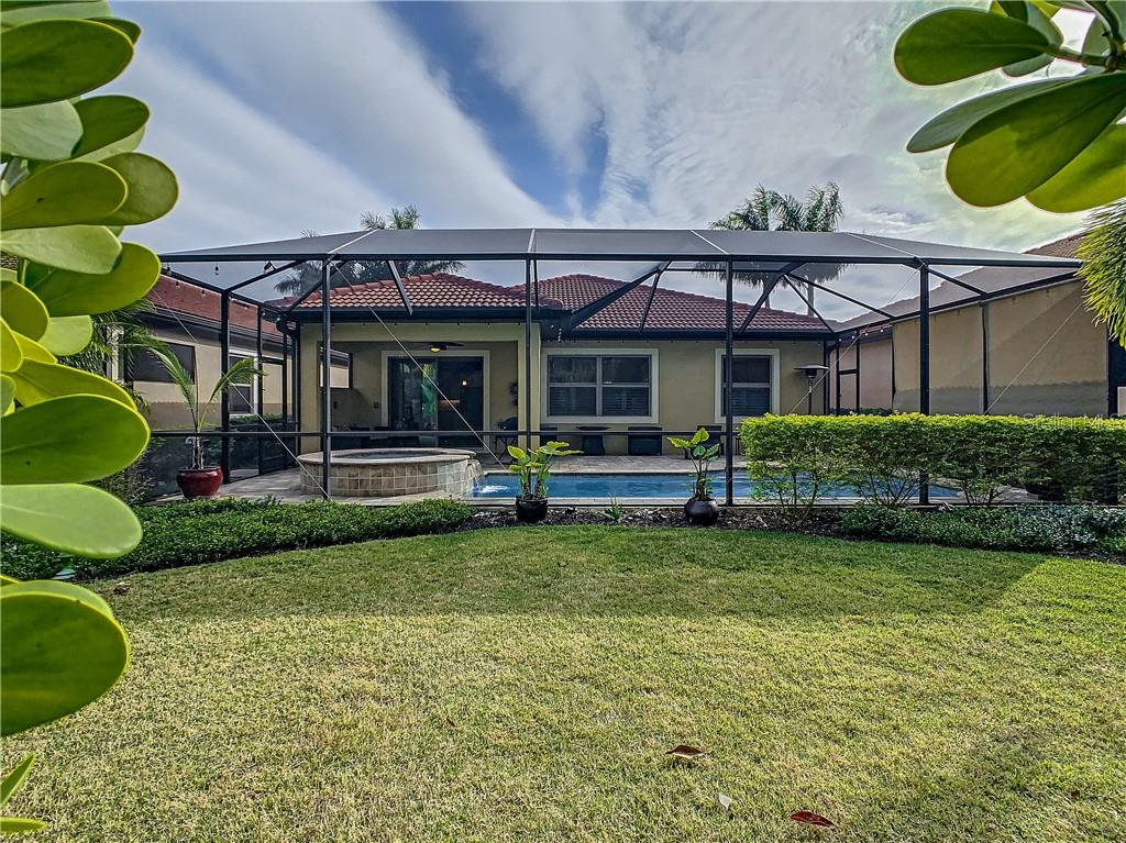 Rear exterior - Single Family Home for sale at 108 Maraviya Blvd, North Venice, FL 34275 - MLS Number is N6113946