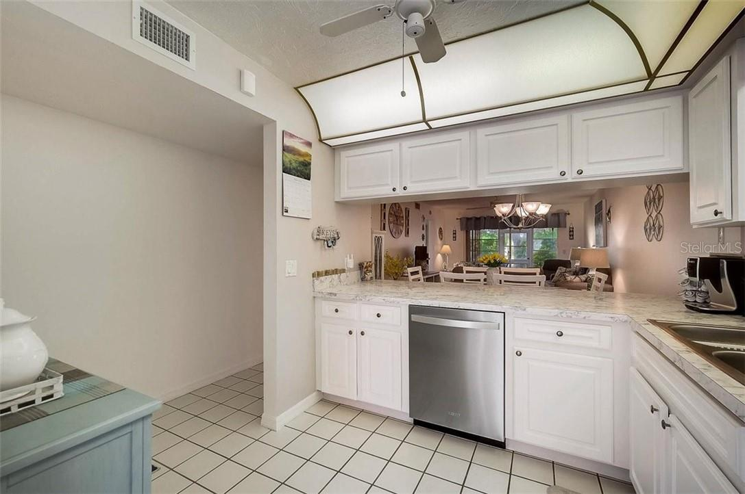 Kitchen - Condo for sale at 1041 Capri Isles Blvd #105, Venice, FL 34292 - MLS Number is N6114557