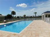 Community Pool - Villa for sale at 1649 Monarch Dr #1649, Venice, FL 34293 - MLS Number is N5909224