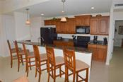 Kitchen/Breakfast Bar - Condo for sale at 1100 San Lino Cir #1134, Venice, FL 34292 - MLS Number is N5910364