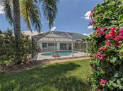 Rear exterior - Single Family Home for sale at 683 May Apple Way, Venice, FL 34293 - MLS Number is N5913909