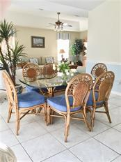 Casual nook area for dining between  kitchen and family room - Single Family Home for sale at 4265 Irdell Ter, North Port, FL 34288 - MLS Number is N5915255