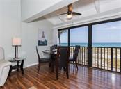 Former lanai converted to functional dining area with white vaulted wood beam ceiling. - Condo for sale at 500 Park Blvd S #67, Venice, FL 34285 - MLS Number is N6100360