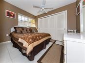 Guest bedroom with two sets of closets. - Single Family Home for sale at 620 Valencia Rd, Venice, FL 34285 - MLS Number is N6100912