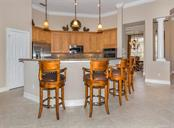 Breakfast bar, kitchen - Single Family Home for sale at 110 Martellago Dr, North Venice, FL 34275 - MLS Number is N6103159
