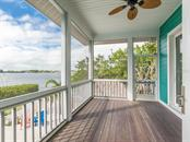 Screened porch with view of Roberts Bay - Single Family Home for sale at 735 Eagle Point Dr, Venice, FL 34285 - MLS Number is N6103576